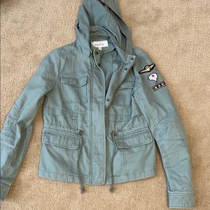 Green army jacket with sleeve detail